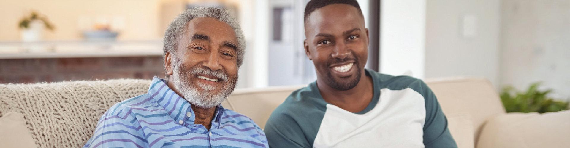 adult man and senior man smiling